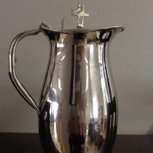 Brocca messa in metallo lucido argentata o dorata diametro base cm.10 h.con croce cm.26.5