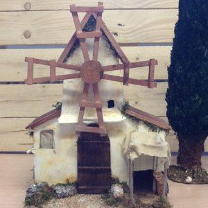 Casa bianca con mulino in movimento elettrico in legno cm.24x17.5x33h