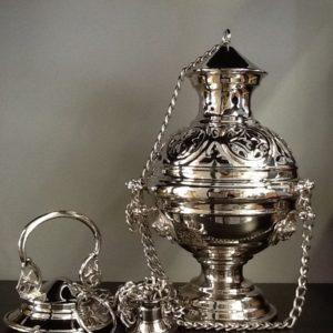 Turibolo in metallo lucido decorato
