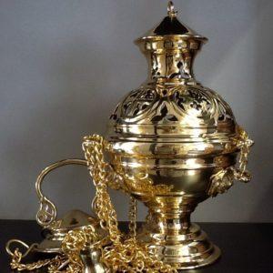 Turibolo in metallo lucido  dorato decorato